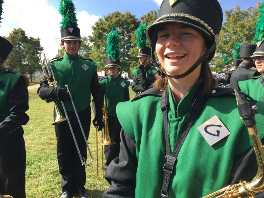 In the back are Jackson Clark and James Baxter, two trombone players. Along with Katrina Fjeld, a saxophone player, on the front right. All in marching uniforms.