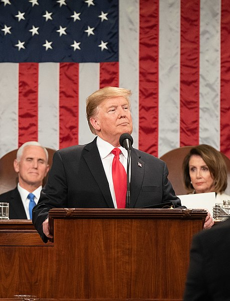 President Donald Trump delivers the State of the Union address with Vice President Mike Pence and Speaker of the House Nancy Pelosi looking on.