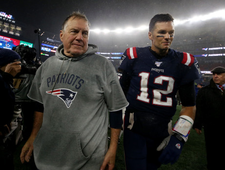 FOXBORO MA. - OCTOBER 27: New England Patriots head coach Bill Belichick smiles as he walks off the field with quarterback Tom Brady after beating the Cleveland Browns 27-13 for his 300th win at Gillette Stadium on October 27, 2019 in Foxboro, MA. (Staff Photo By Nancy Lane/MediaNews Group/Boston Herald)