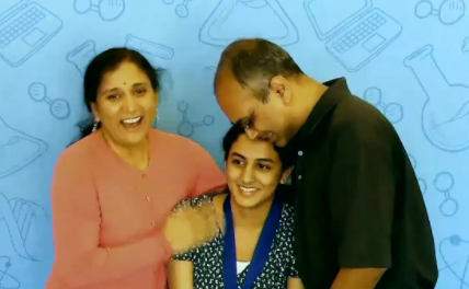 Anika with her parents.